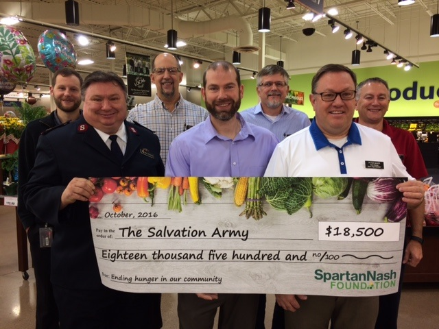 From left: Dan's Supermarket Store Director Neil Heidt, Major John Flanagan of the Salvation Army and Store Directors Loren Olson, Kevin Bailey, Andy Dosch, Peter Bauer and Mike Mosset.